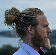 a-photograph-of-a-hipster-male-with-the-perfect-man-bun-hairstyle-placed-on-the-vertex-area-of-his-head-and-styled-with-long-wavy-hair